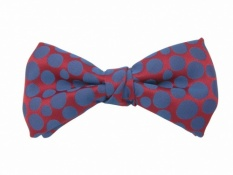 Ready Tied Bow Tie With Purple Spots on Red Background